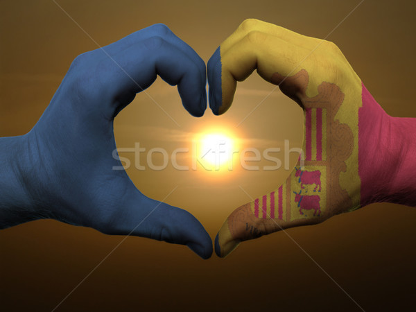 Heart and love gesture by hands colored in andora flag during be Stock photo © vepar5