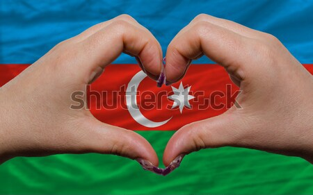 Heart and love gesture showed by hands over flag of tunisia back Stock photo © vepar5