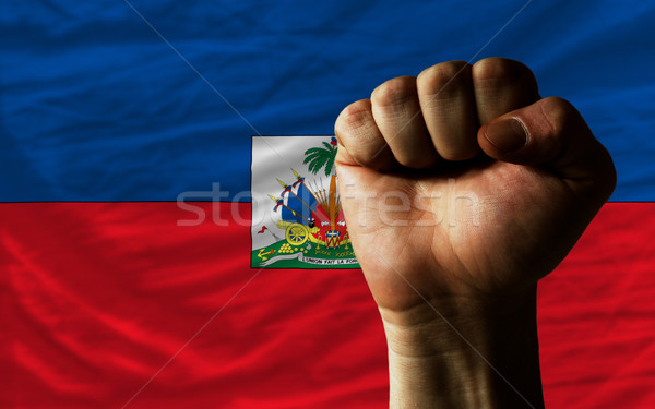 Hard fist in front of haiti flag symbolizing power Stock photo © vepar5
