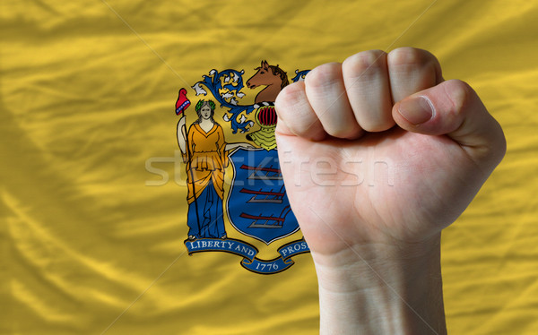 us state flag of new jersey with hard fist in front of it symbol Stock photo © vepar5