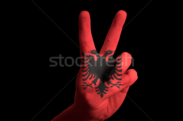 Stock photo: albania national flag two finger up gesture for victory and winn