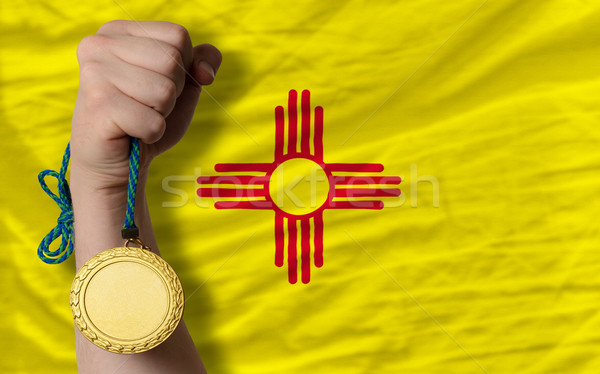 Gold medal for sport and  flag of american state of new mexico   Stock photo © vepar5