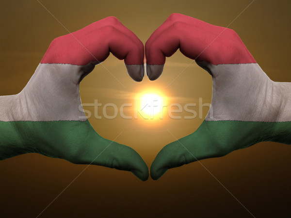 Heart and love gesture by hands colored in hungary flag during b Stock photo © vepar5
