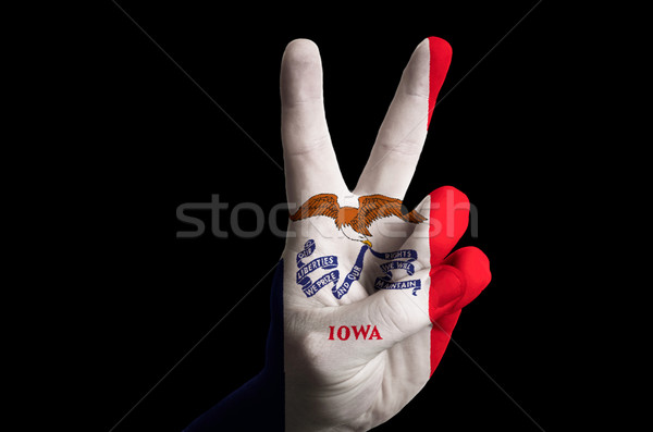iowa us state flag two finger up gesture for victory and winner  Stock photo © vepar5