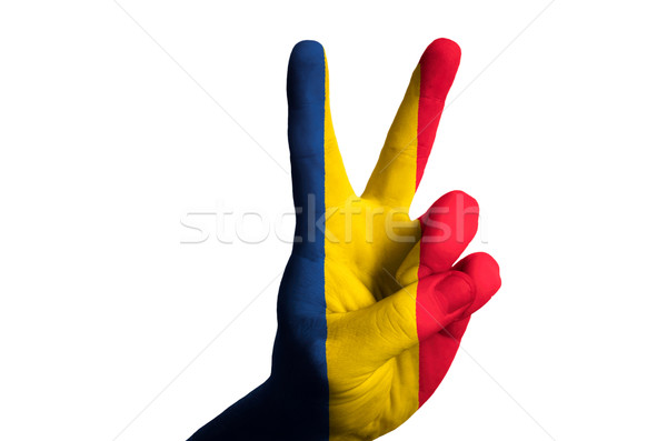 romania national flag two finger up gesture for victory and winn Stock photo © vepar5