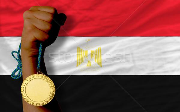 Gold medal for sport and  national flag of egypt    Stock photo © vepar5