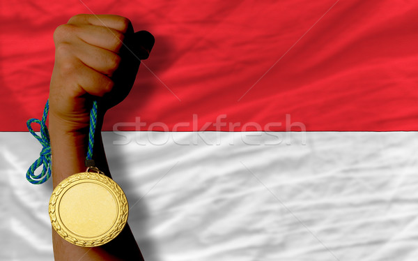 Stock photo: Gold medal for sport and  national flag of indonesia