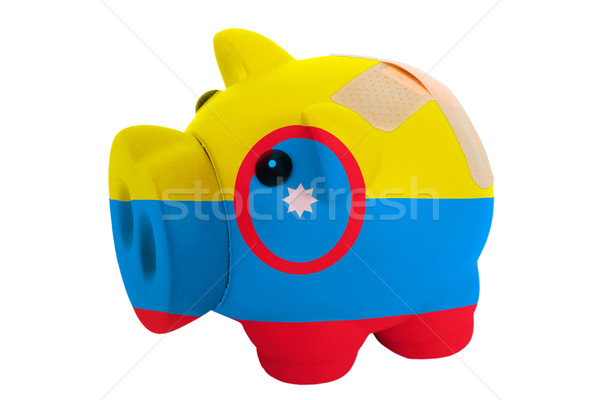 closed piggy rich bank with bandage in colors national flag of c Stock photo © vepar5