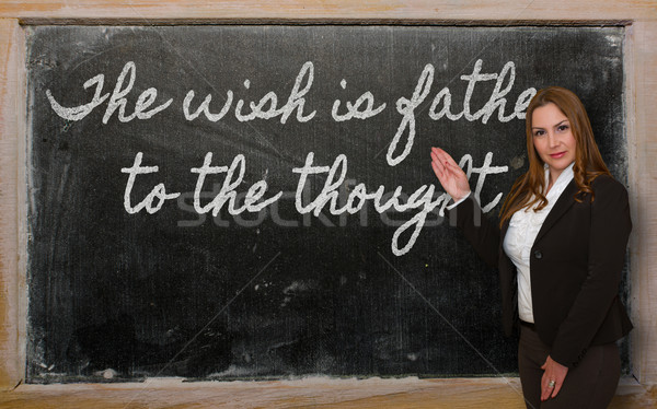 Teacher showing The wish is father to the thought on blackboard Stock photo © vepar5