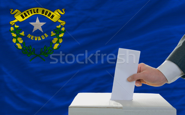 man voting on elections in front of flag US state flag of nevada Stock photo © vepar5