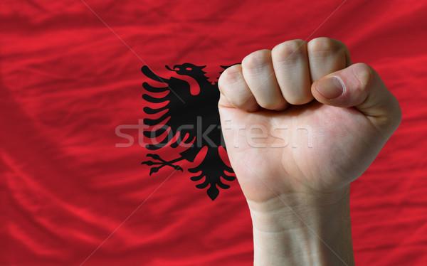 Hard fist in front of albania flag symbolizing power Stock photo © vepar5