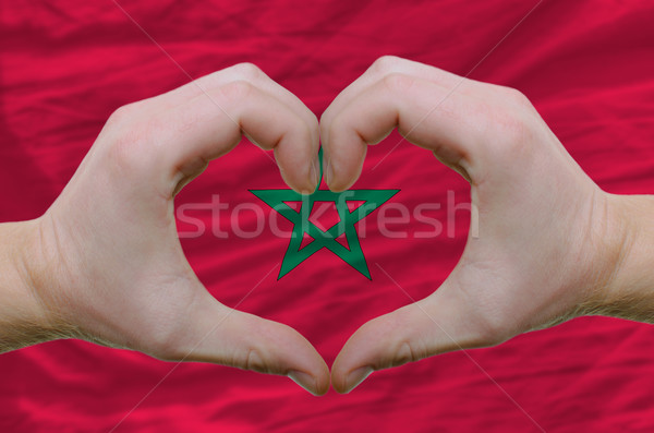 Heart and love gesture showed by hands over flag of morocco back Stock photo © vepar5