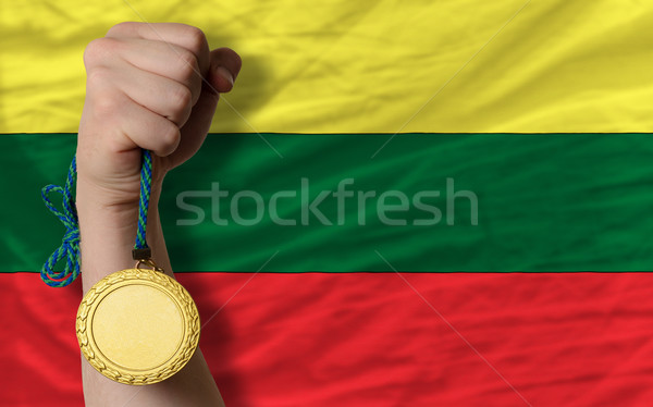 Gold medal for sport and  national flag of lithuania    Stock photo © vepar5