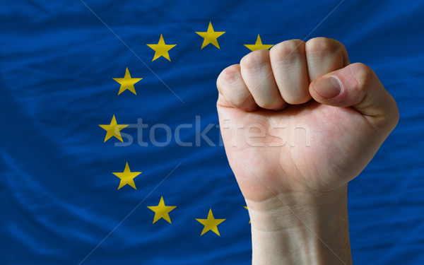 Hard fist in front of europe flag symbolizing power Stock photo © vepar5