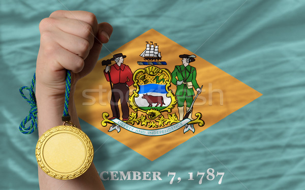 Gold medal for sport and  flag of american state of delaware    Stock photo © vepar5