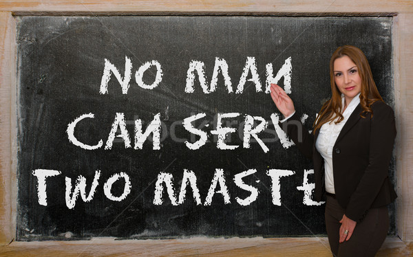 Teacher showing No man can serve two masters on blackboard Stock photo © vepar5