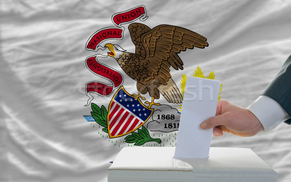 man voting on elections in front of flag US state flag of illino Stock photo © vepar5