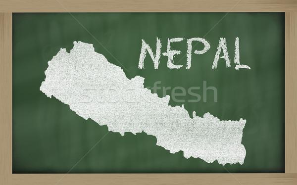 outline map of nepal on blackboard  Stock photo © vepar5