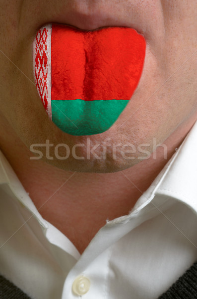 man tongue painted in belarus flag symbolizing to knowledge to s Stock photo © vepar5