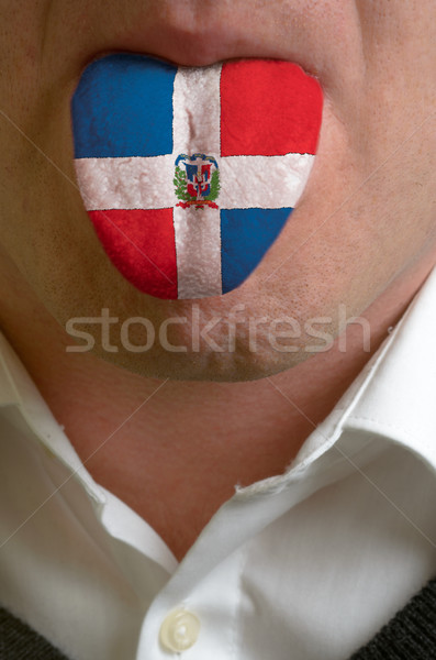 man tongue painted in dominica flag symbolizing to knowledge to  Stock photo © vepar5