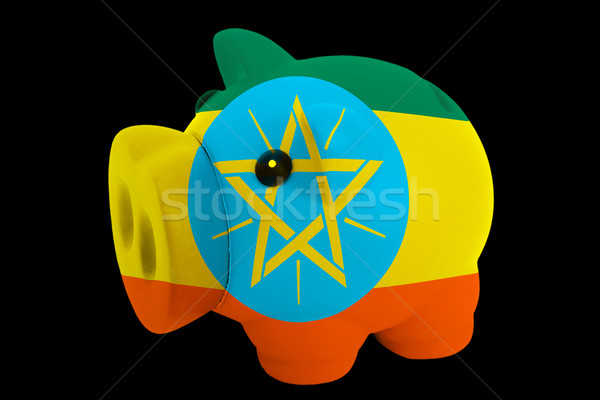 piggy rich bank in colors national flag of ethiopia   for saving Stock photo © vepar5