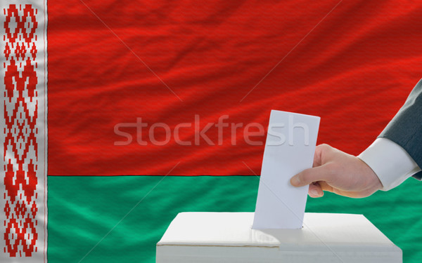 Stock photo: man voting on elections in belarus