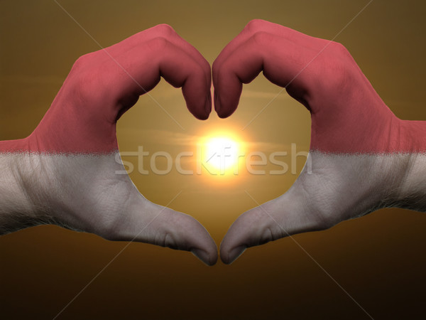Heart and love gesture by hands colored in indonesia flag during Stock photo © vepar5