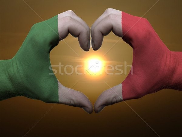 Stock photo: Heart and love gesture by hands colored in italy flag during bea