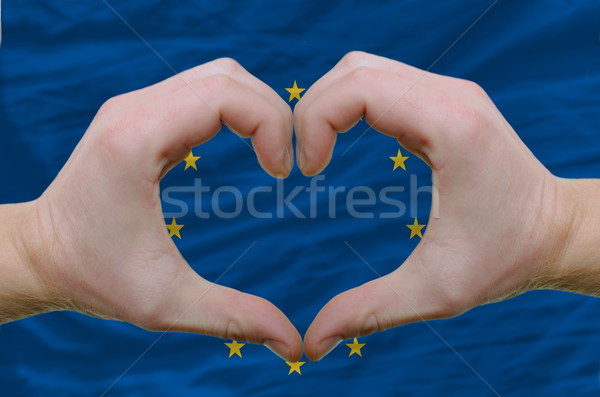 Heart and love gesture showed by hands over flag of eu backgroun Stock photo © vepar5