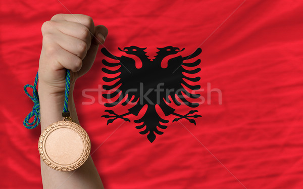 Stock photo: Bronze medal for sport and  national flag of albania