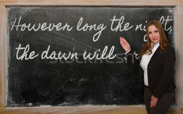 Stock photo: Teacher showing However long the night, the dawn will  break on