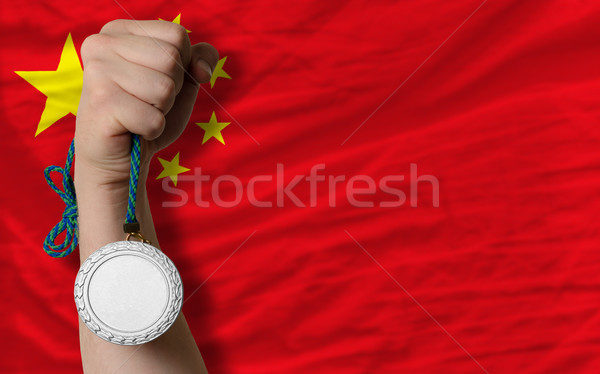 Stock photo: Silver medal for sport and  national flag of china