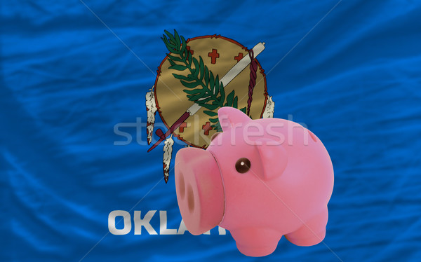 piggy rich bank and  flag of american state of oklahoma    Stock photo © vepar5