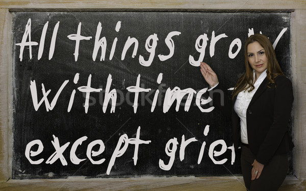Teacher showing All things grow with time - except grief on blac Stock photo © vepar5