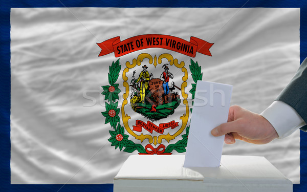 man voting on elections in front of flag US state flag of west v Stock photo © vepar5