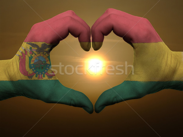 Heart and love gesture by hands colored in bolivia flag during b Stock photo © vepar5