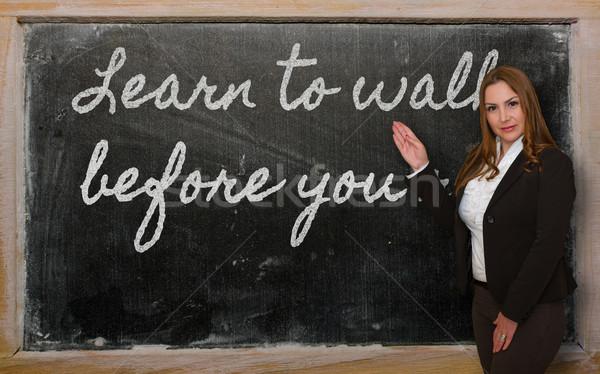 Teacher showing Learn to walk before you run on blackboard Stock photo © vepar5