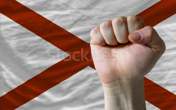 us state flag of alabama with hard fist in front of it symbolizi Stock photo © vepar5