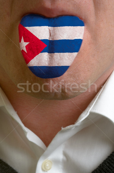man tongue painted in cuba flag symbolizing to knowledge to spea Stock photo © vepar5