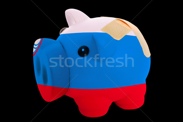 bankrupt piggy rich bank in colors of national flag of slovenia  Stock photo © vepar5