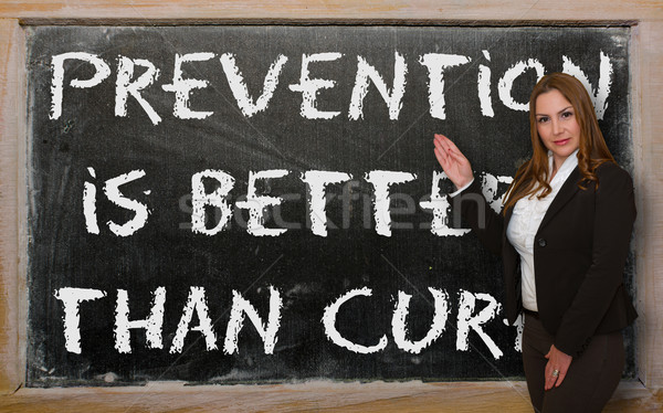 Teacher showing Prevention is better than cure on blackboard Stock photo © vepar5