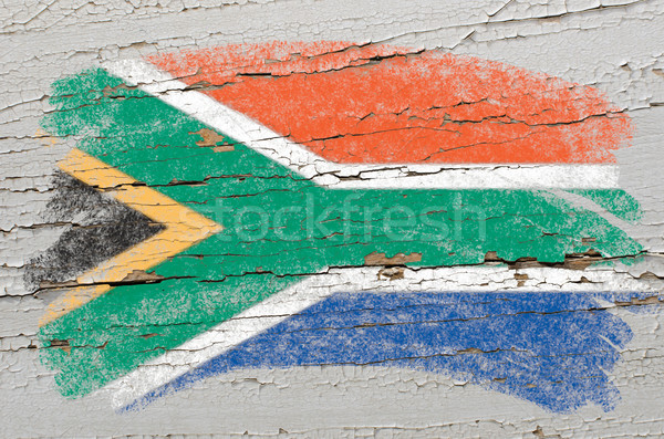 flag of South Africa on grunge wooden texture painted with chalk Stock photo © vepar5