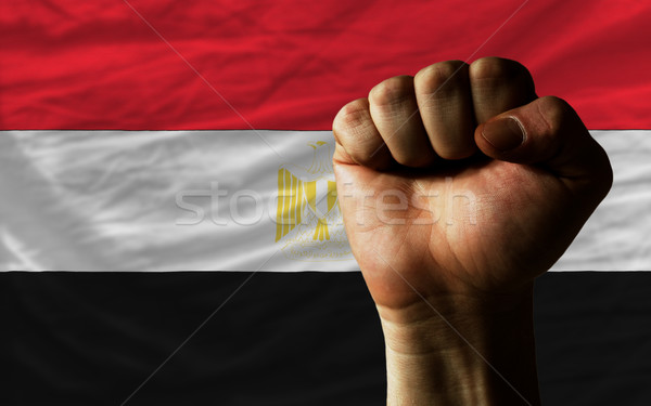 Hard fist in front of egypt flag symbolizing power Stock photo © vepar5