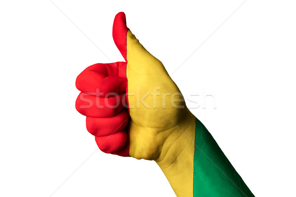 Stock photo: guinea national flag thumb up gesture for excellence and achieve
