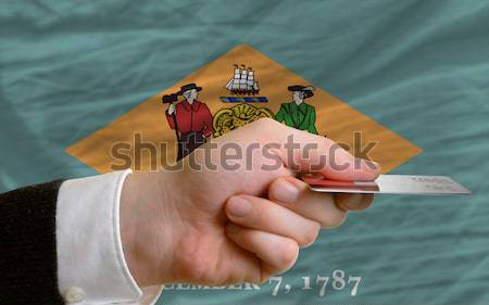 in front of american state flag of delaware two businessmen hand Stock photo © vepar5