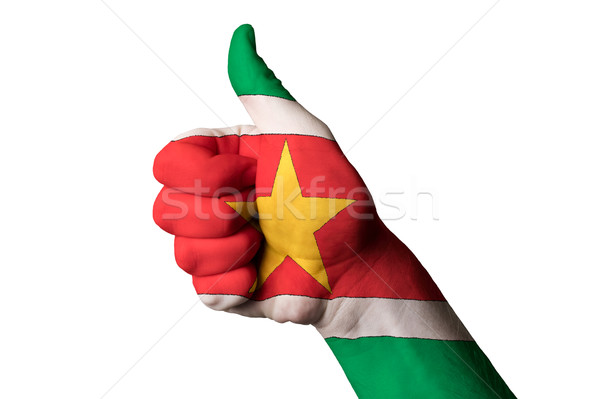 Stock photo: surinam national flag thumb up gesture for excellence and achiev