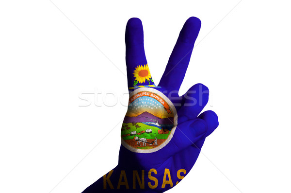 kansas us state flag two finger up gesture for victory and winne Stock photo © vepar5
