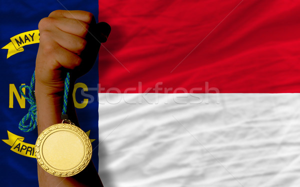 Gold medal for sport and  flag of american state of north caroli Stock photo © vepar5