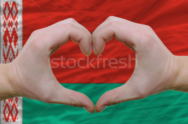 Heart and love gesture showed by hands over flag of belarus back Stock photo © vepar5