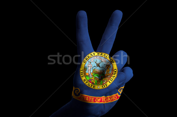 idaho us state flag two finger up gesture for victory and winner Stock photo © vepar5